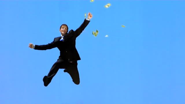 HD Super Slow-motion: Dollari cadere su felice Uomo d'affari