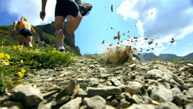HD Super Slow-Mo: Extreme Runner Kicking The Sand