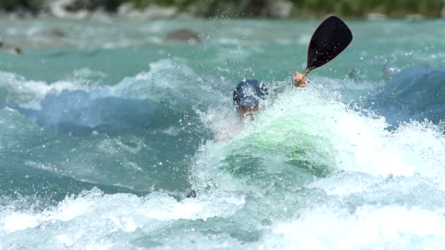 HD Super Slow-Mo: Extreme Whitewater Kayaker In Action