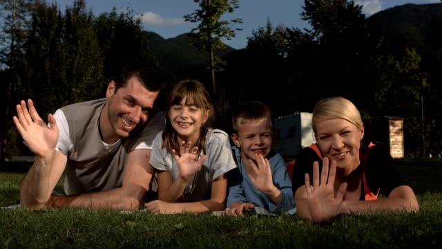 HD Super Slow-Mo: Family Waving At Camera