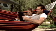 HD Super Slow-Mo: Father And Daughter Using A Digital Tablet
