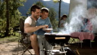 HD Super Slow-Mo: Father Teaching His Son How To BBQ