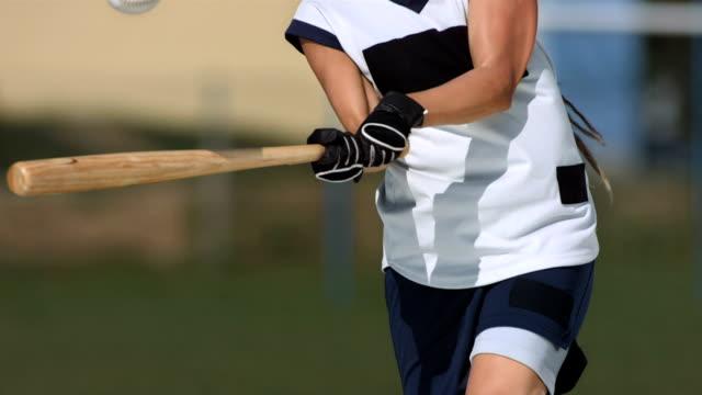 HD Super Slow-Mo: Female Softball Player Batting Ball