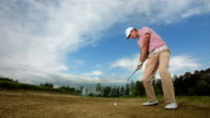 HD Super Slow-Mo: Golfer Hitting Ball From Sand Trap