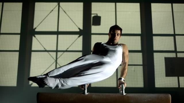 HD Super Slow-Mo: Gymnast Swings Legs On Pommel Horse