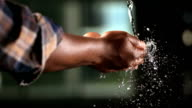 HD Super Slow-Mo: Hands Catching Falling Water