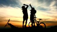 HD Super Slow-Mo: Happy Bikers Giving A High-Five