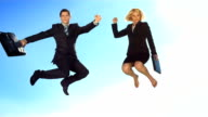 HD Super Slow-Mo: Happy Business People Jumping In The Sky
