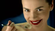 HD Super Slow-Mo: Happy Young Woman Eating Spaghetti