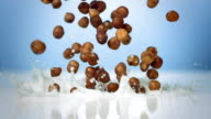 HD Super Slow-Mo: Hazelnuts Splashing Into Milk