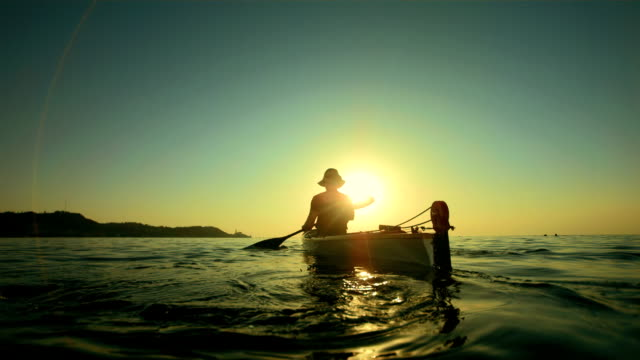 HD Super Slow-Mo: Kayaking Toward The Sunset Horizon