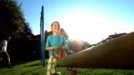 HD Super Slow-Mo: Kids Having Fun On A Playground