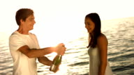 HD Super Slow-Mo: Man Spraying His Girlfriend With Champagne