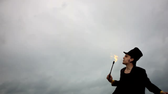 HD Super Slow-Mo: Performer Breathing Fire