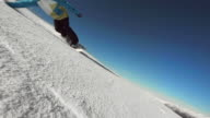 HD Super Slow-Mo: Professional Snowboarder Carving Through Snow