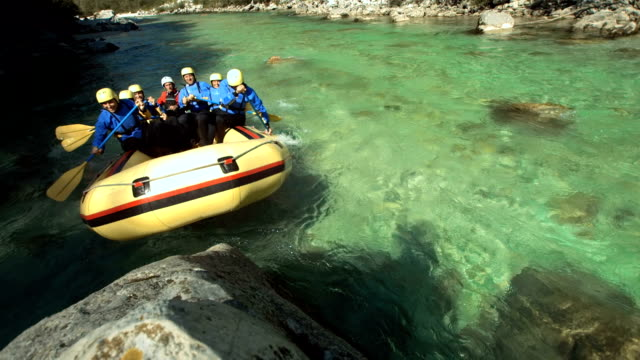 HD Super Slow-Mo: Rafters Running The Raft On A Rock