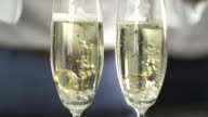 HD Super Slow-Mo: Ring Dropping In Champagne