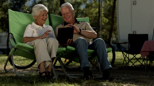 HD Super Slow-Mo: Senior Couple Video Chatting At Campsite