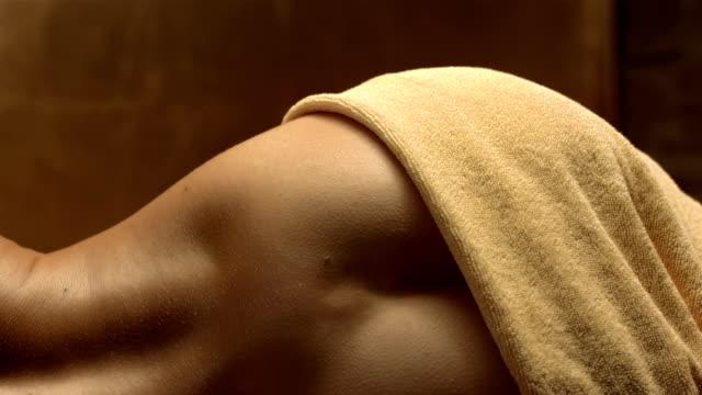 HD Super Slow-Mo: Sensual Woman Lying In Sauna