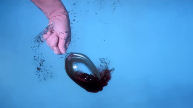 HD Super Slow-Mo: Sinking A Glass With Red Wine