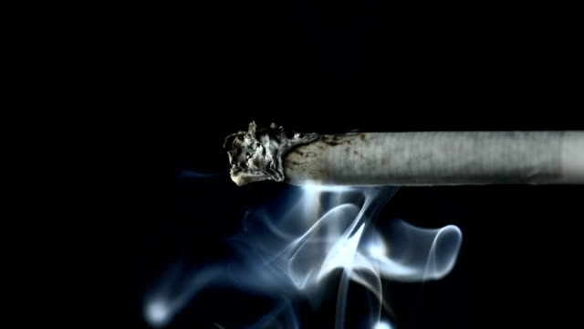 HD Super Slow-Mo: Smoke Coming From A Cigarette