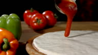 HD Super Slow-Mo: Spreading Tomato Sauce On Dough