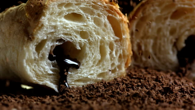 HD Super Slow-Mo: Sprinkling Chocolate Flakes Over Croissants