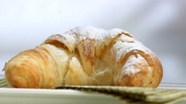 HD Super Slow-Mo: Sprinkling Powdered Sugar Over Croissant