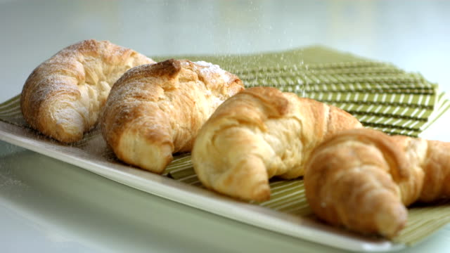 HD Super Slow-Mo: Sprinkling Powdered Sugar Over Croissants