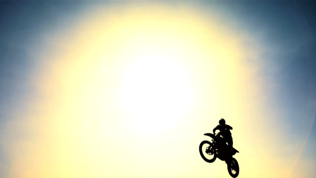 HD Super Slow-Mo: Stunt Dirt Biker In The Air