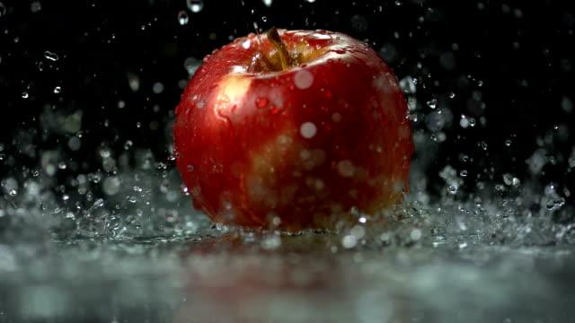 HD Super Slow-Mo: Water Drops Falling On Apple
