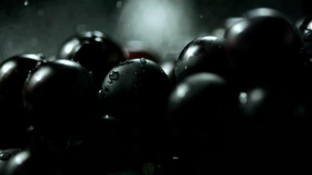 HD Super Slow-Mo: Water Drops Falling On Black Grapes