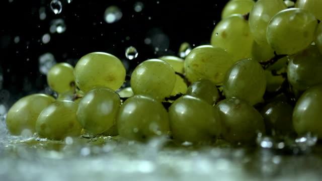HD Super Slow-Mo: Water Drops Falling On Grapes
