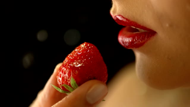 HD Super Slow-Mo: Wet Woman's Lips And Strawberry