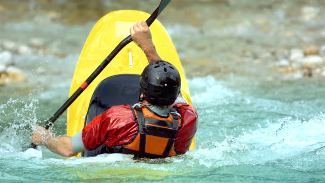 HD Super Slow-Mo: Whitewater Kayaker Rolling On The Rapids