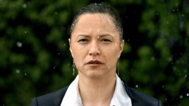 HD Super Slow-Mo: Worried Businesswoman In The Rain