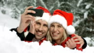 HD Super Slow-Mo: Xmas Couple Taking Photos With Mobile Phone