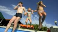 HD Super Slow-Mo: Young Family Jumping Into Pool