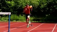 HD Super Slow-Mo: Young man at 110m hurdle run