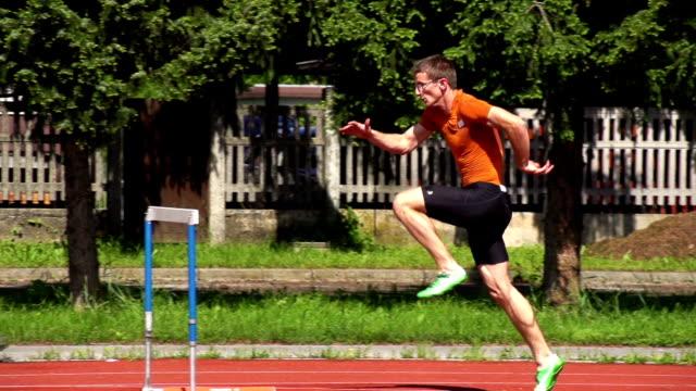 HD Super Slow-Mo: Young man at hurdle run