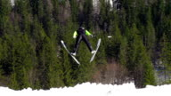 HD Super Slow-Mo: Young Man Performing Ski Jump