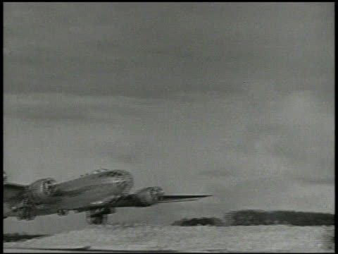 Superfortress bomber aircrafts taxiing on runway of military airbase B29's taking off from runway B29 flying toward over frame WWII XXI Bomber...
