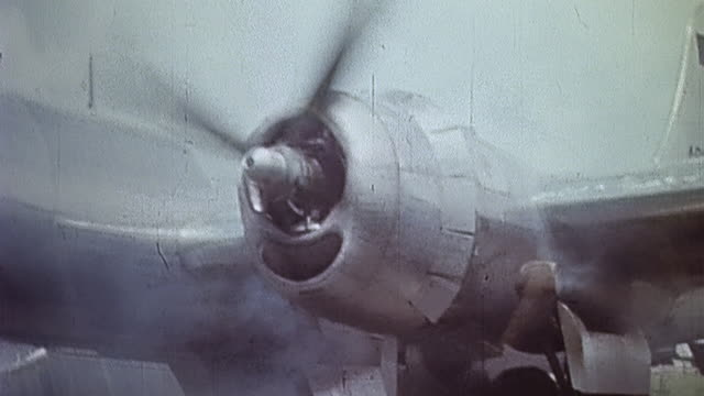 Superfortress engines starting and propellers turning