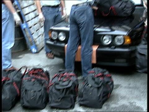 Supergrass Drug Dealers Release ITN LIB London SEQ Heroin haul found in car displayed