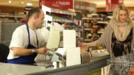 Supermarket / Grocery Store shopping checkout till cashier