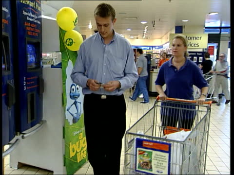 Supermarket loyalty cards Unknown location BV woman at checkout loading up bag Steve Johnson interview SOT shoppers want to see pounds not points /...