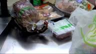 London Asda Supermarket INT Various shots of shoppers at supermarket checkout tills/ various of food items being scanned at supermarket checkout...