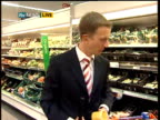 Supermarkets report on attempts to reduce packaging waste Reporter to camera
