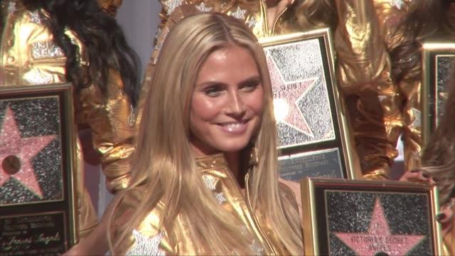 Supermodel Heidi Klum and Victoria's Secret Models Hollywood Walk of Fame Victorias' Secret Models receive a star on the Hollywood Walk of Fame...