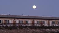 Supermoon over beachfront motel